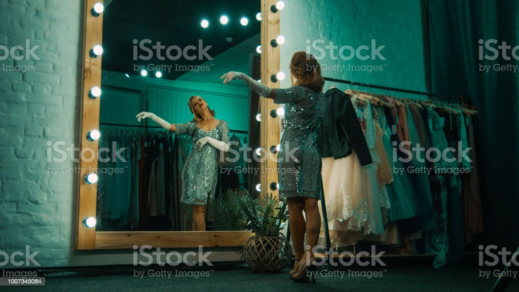 Elegant woman in dressing room before show stock photo