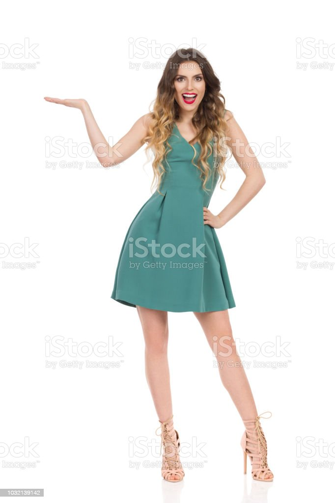 252c0a42490f Elegant Woman In Mini Dress And High Heels Is Presenting And Talking - Stock  image .