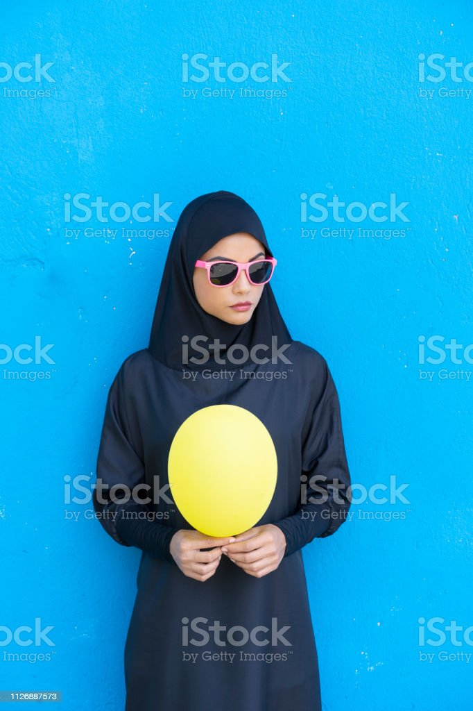 Elegant Woman In Traditional Clothes Holding Yellow Balloon Stock