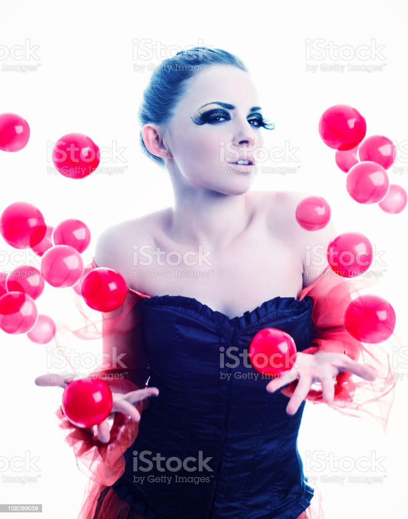 Elegant Woman Juggling Red Bubbles royalty-free stock photo