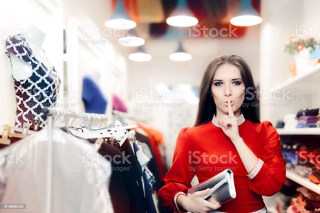 Elegant Woman Keeping a Secret in Fashion Store stock photo