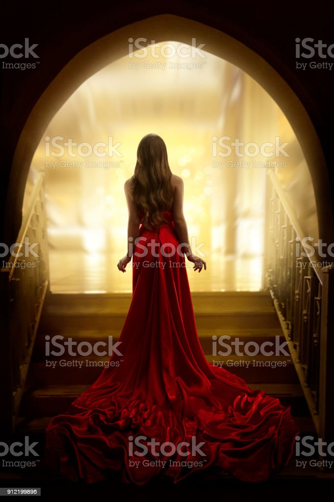 Elegant Woman Silhouette in Long Gown, Lady Rear View, Fashion Model Dress Waving on Stairs stock photo