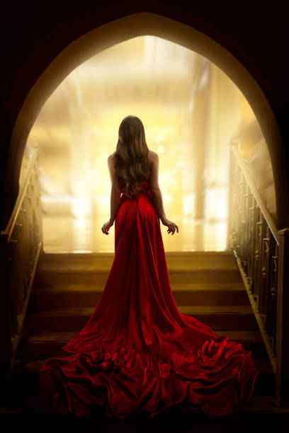 elegant woman silhouette in long gown, lady rear view, fashion model dress waving on stairs - fantasy stock photos and pictures