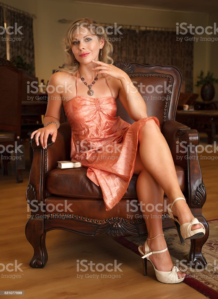 Royalty Free Legs Crossed At Knee Chair Women Leather