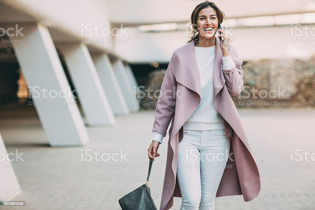 Elegant woman talking on the phone stock photo