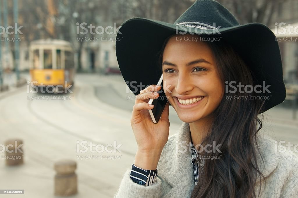Elegant woman using smartphone on the street stock photo