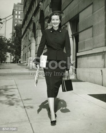 istock Elegant woman walking on sidewalk, (B&W) 57417041