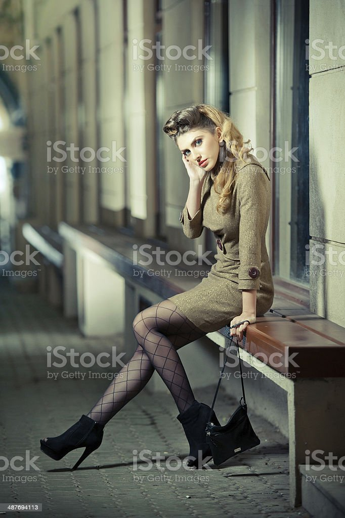Elegant woman wearing outfit with Russian influence posing relaxed stock photo