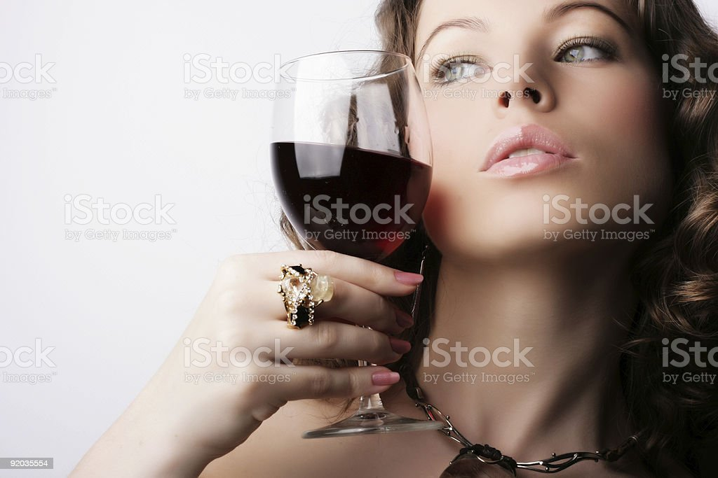Elegant woman with a glass of red wine royalty-free stock photo