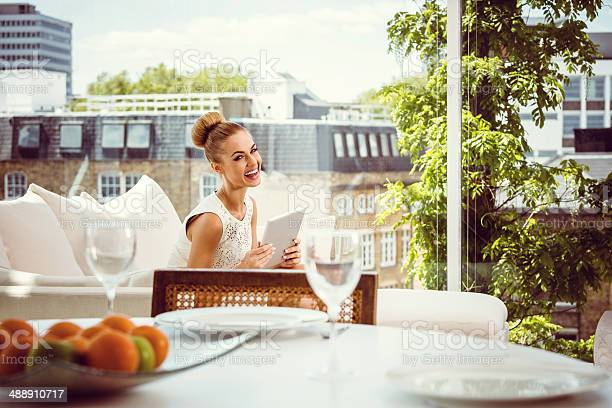 Elegant Woman With Digital Tablet Stock Photo - Download Image Now