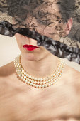 istock Elegant woman with pearl necklace 490852881