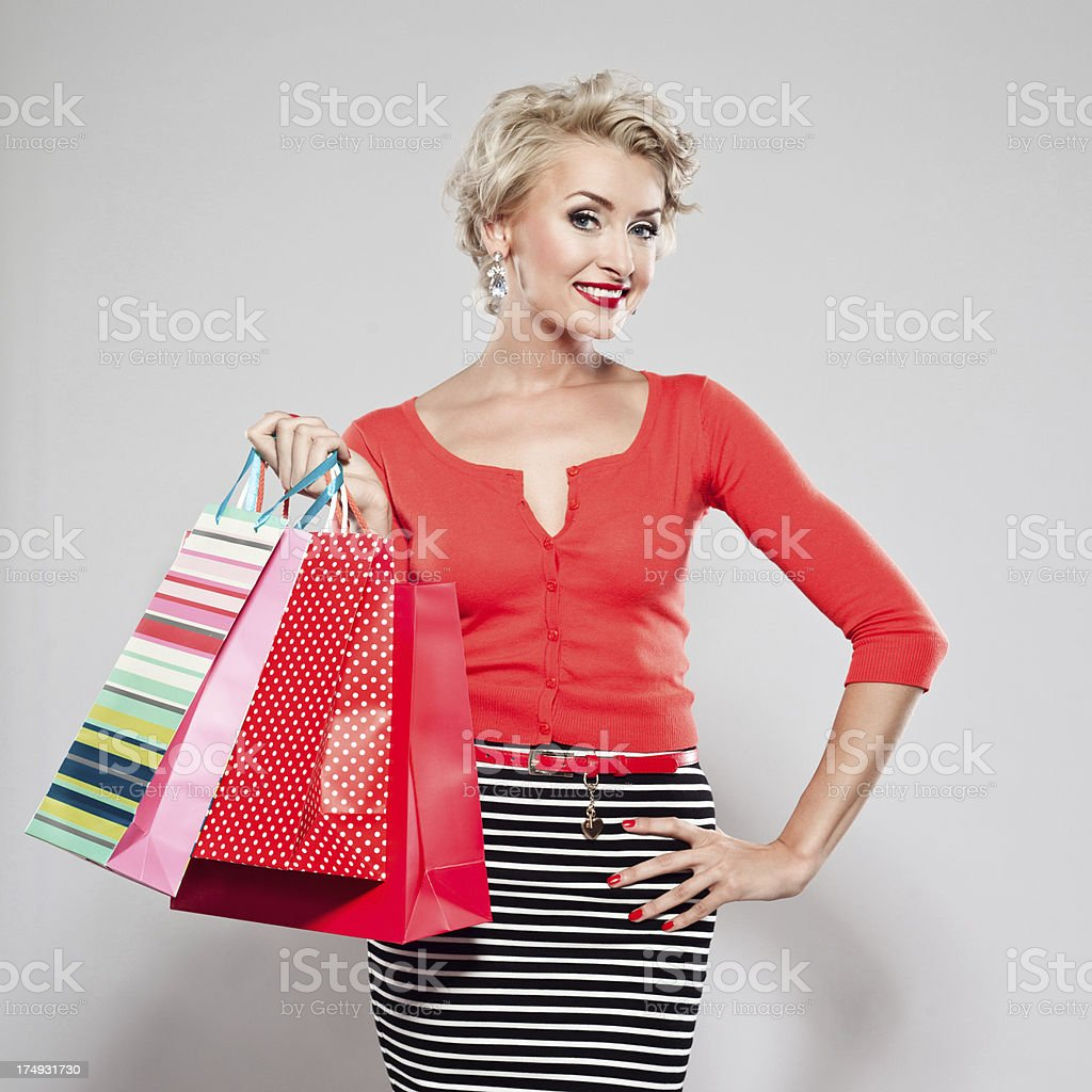 Elegant woman with shopping bags royalty-free stock photo