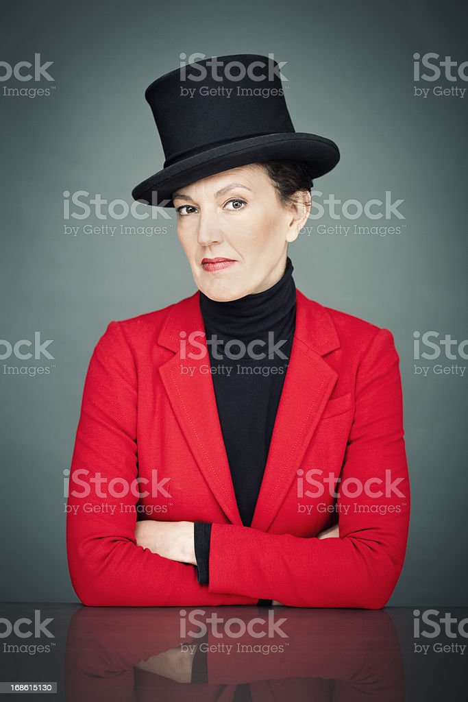 Elegant woman with top hat and red suit. stock photo