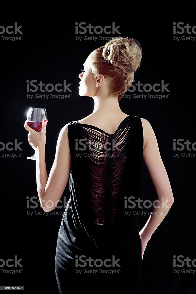 Elegant woman with wineglass royalty-free stock photo