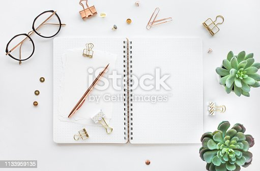 istock Elegant work table with business accessories on withe background.luxury feminism style 1133959135