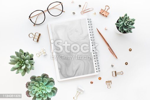 istock Elegant work table with business accessories on withe background.luxury feminism style 1134051325
