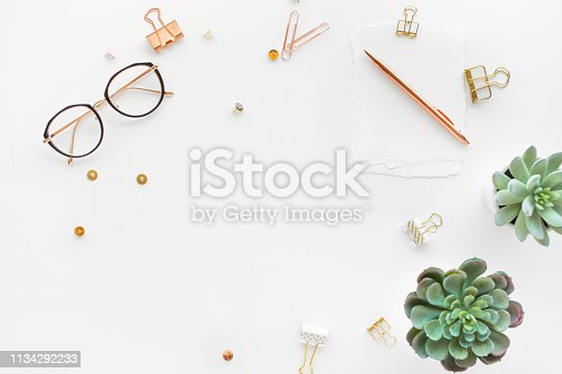 istock Elegant work table with business accessories on withe background.luxury feminism style 1134292233