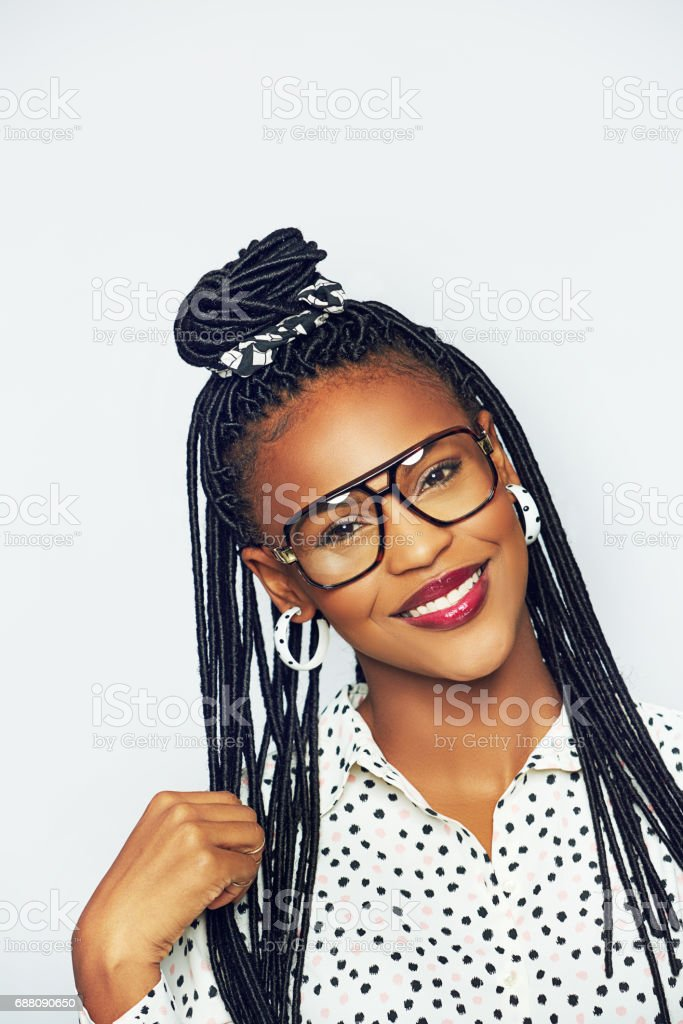 Elegant young African woman with hair extensions stock photo