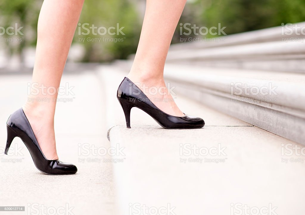 Elegant young businesswoman is going to work stock photo