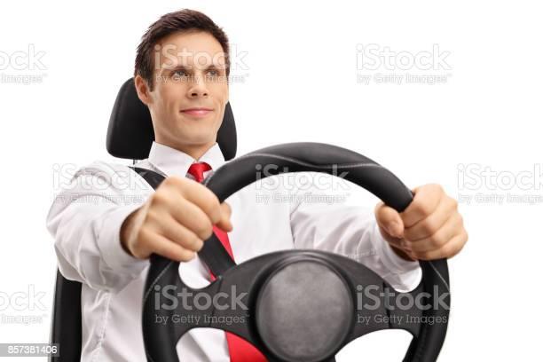 Elegant young man driving picture id857381406?b=1&k=6&m=857381406&s=612x612&h=rp78kas jf9kimzriadmcyvgetf8vqhost3ec3u nnu=