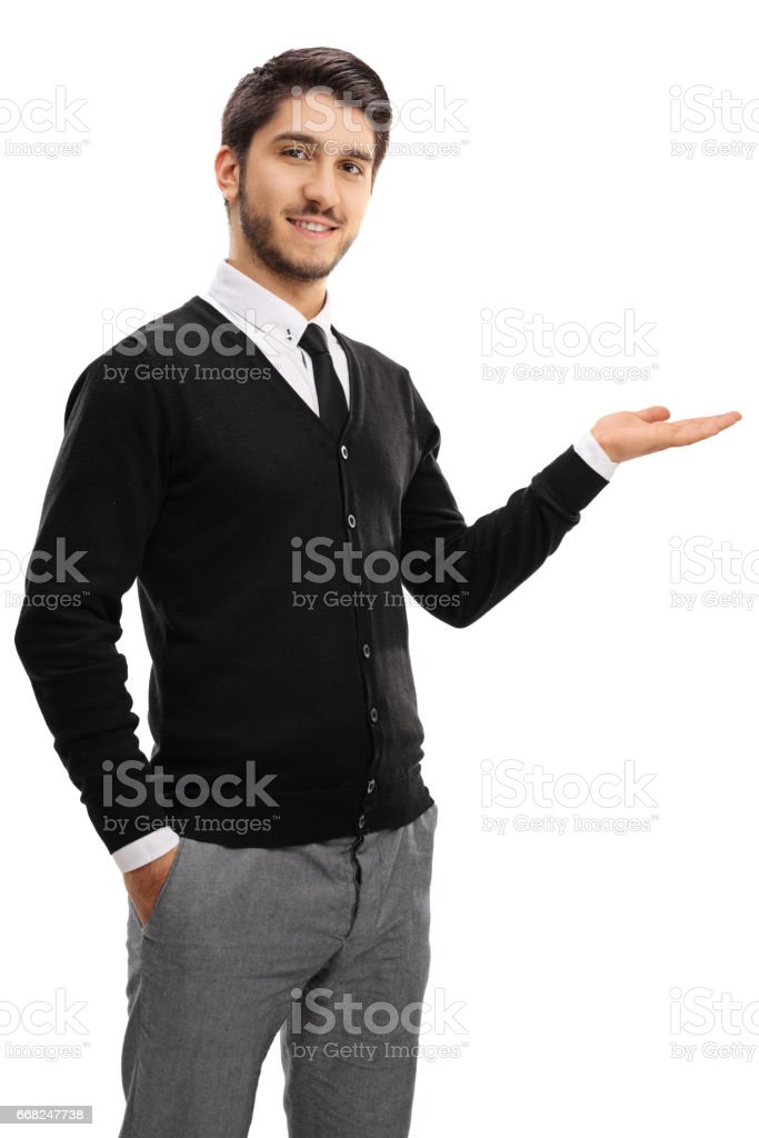 Elegant young man gesturing with his hand foto stock royalty-free