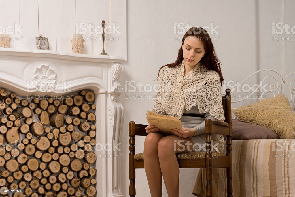 Elegant young woman in her living room royalty-free stock photo