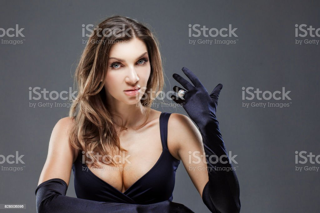 Elegant young woman in long black gloves. Woman with a beautiful ring, jewelry stock photo