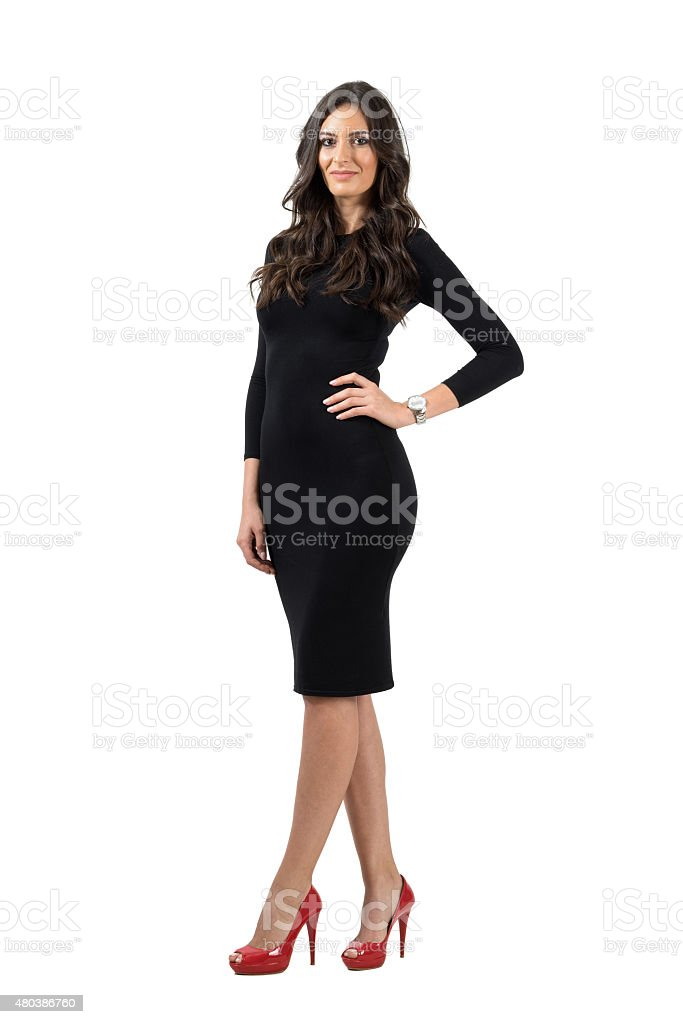 Elegant young woman in short little dress looking at camera stock photo