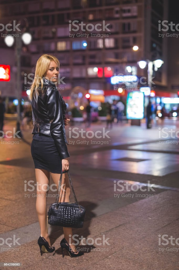 Elegant young woman in the street at night royalty-free stock photo