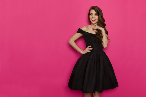istock Elegant Young Woman Is Looking Away, Smiling And Thinking 915320148