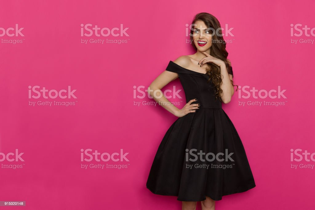 Elegant Young Woman Is Looking Away, Smiling And Thinking stock photo