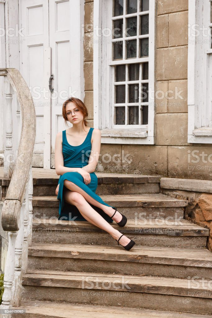 Elegant Young Woman On Stair Of An Old Palace Stock Photo