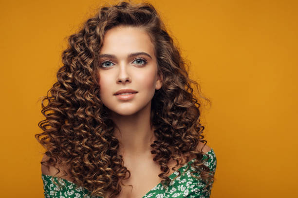 Elegant young woman Elegant young woman curly hair stock pictures, royalty-free photos & images