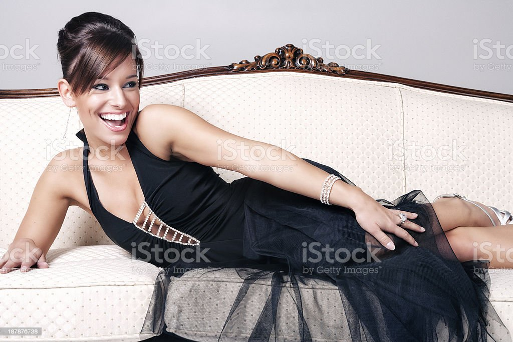 Elegant Young Woman Posing on Antique Sofa royalty-free stock photo
