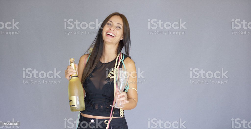 Elegant young woman toasting the New Year foto royalty-free