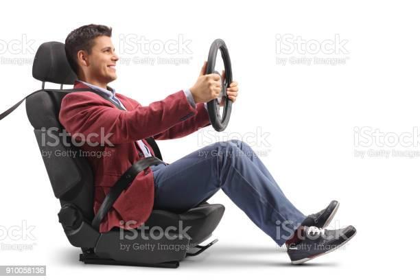 Elegantly dressed guy sitting in a car seat and driving picture id910058136?b=1&k=6&m=910058136&s=612x612&h= k7bfgeupafcci5bkcc4skazl1sprpqb uzi9kxn16w=