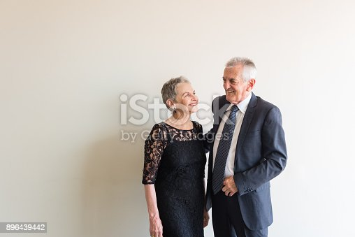 istock Elegantly dressed older couple 896439442