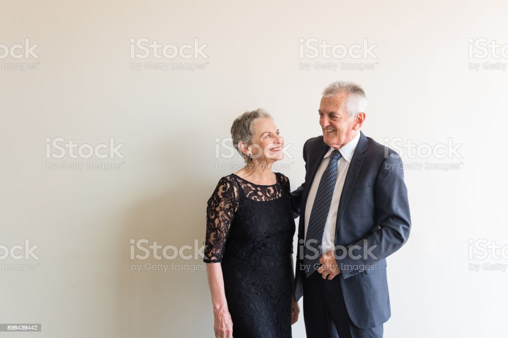 Elegantly dressed older couple stock photo