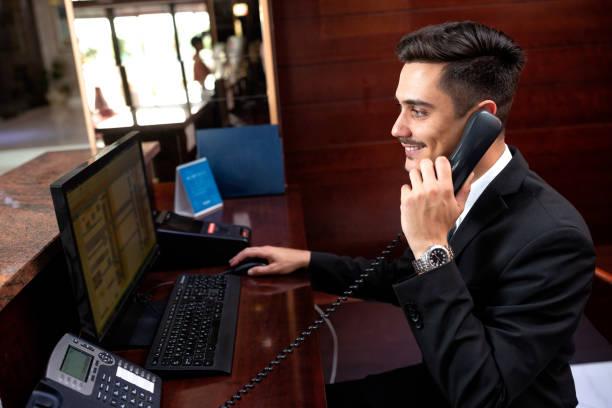 Elegantly dressed receptionist holding a headphone stock photo