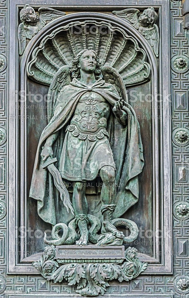 Element of decorative gates, statue of the Archangel Michael stock photo