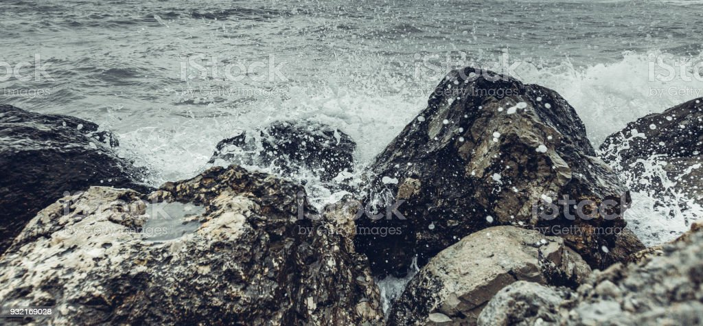 Element Strength Concept. Waves Breaking On The Shore With Sea Foam, Close-up. Nature Trevel Adventure Stones Sea stock photo