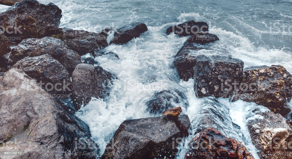 Element Strength Concept. Waves Breaking On The Shore With Sea Foam, Close-up. Nature Trevel stock photo