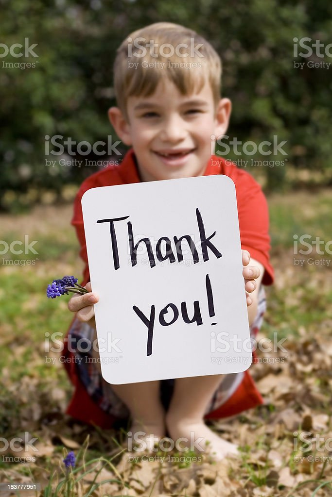 Elementary Age Boy Holding Thank You Sign stock photo