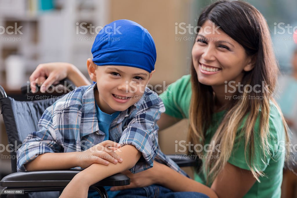 Elementary age boy in wheelchair in hospital stock photo