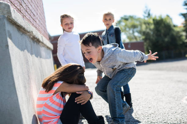 Elementary Age Bullying in Schoolyard sad moment Elementary Age Bullying in Schoolyard cruel stock pictures, royalty-free photos & images
