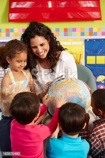 istock Elementary Age Schoolchildren In Geography Class With Teacher 163520492
