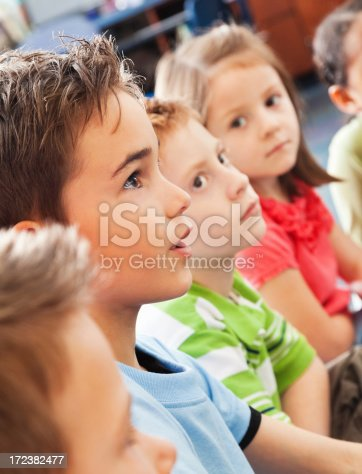 istock Elementary age students listening intently during story time 172382477