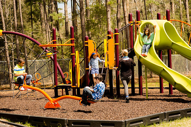 elementary children play at school recess or park on playground. - recess stock photos and pictures