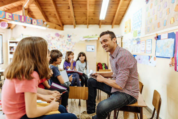 Elementary education in Latin America - brainstorming with teacher after the class stock photo