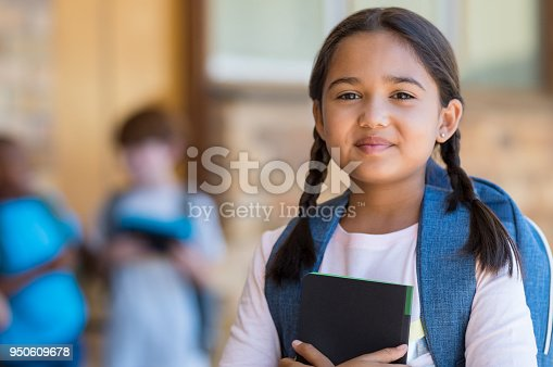 istock Elementary girl at school 950609678